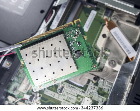 Closeup of electronic circuit board with processor,repair and maintenance of digital technology,,fixing computer,fix computer - stock photo