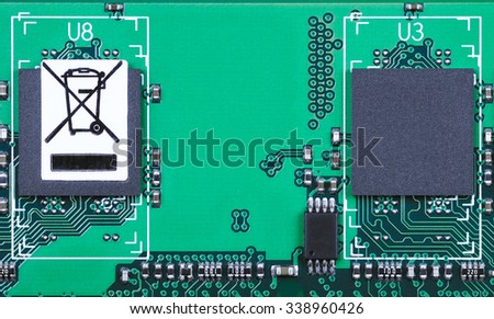 "Closeup of electronic PCB with ""do not trash"" sign. - stock photo"