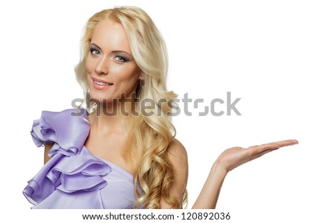 Closeup of elegant woman in lilac dress holding copy space on her open palm, isolated on white background