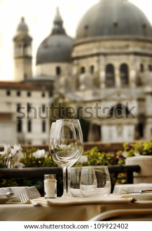 closeup of empty wine glasses in Venice, Italy - stock photo