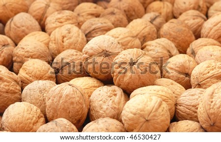 Closeup of English walnuts - background
