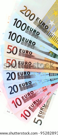 Closeup of euro banknotes, fan made of euro paper currency; isolated on white background - stock photo