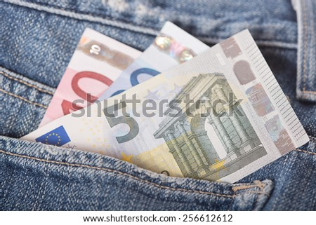 Closeup of euro banknotes in the jeans pocket - stock photo