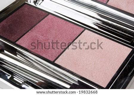 Closeup of eye-shadows of three colors - stock photo