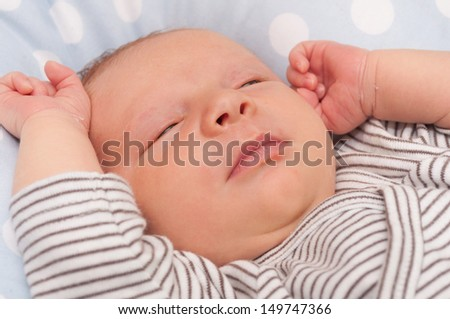 Closeup of Face of Lying Newborn Baby