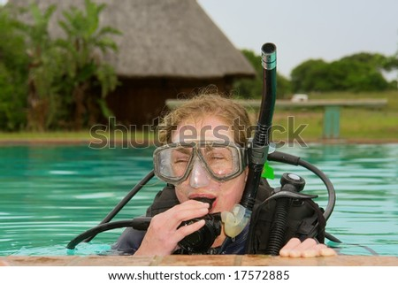 Closeup of female student in divers training pool. - stock photo