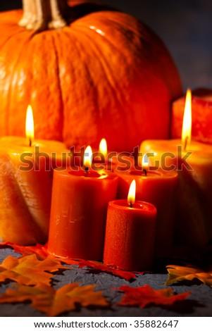 Closeup of festive aromatic candles burning merrily - fall theme - stock photo