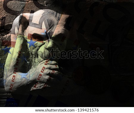 Closeup of fifty euro banknotes overlaid with gargoyles figure - stock photo