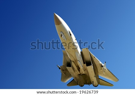 Closeup of fighter jet from below - stock photo