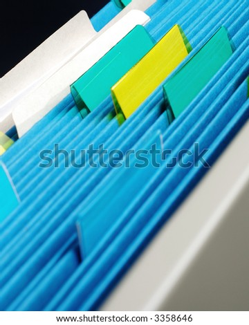 closeup of file folders in file cabinet drawer - stock photo