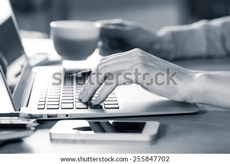 closeup of fingers on the keyboard - stock photo