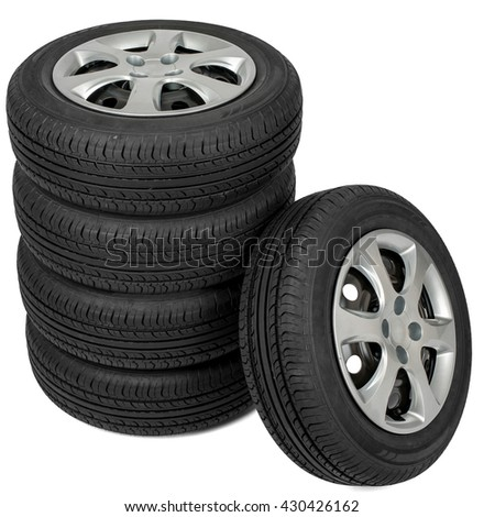 Closeup of five tires, isolated over white background