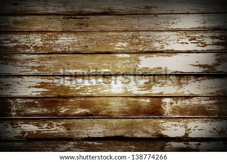 Closeup of flaking paint on boards - stock photo