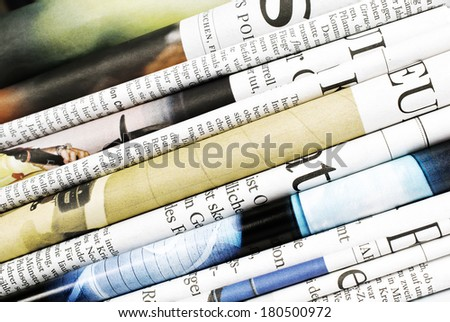 Closeup of folded newspapers - stock photo