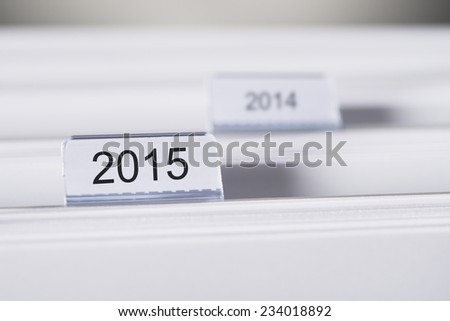 Closeup of folders marked with 2015 and 2014 - stock photo