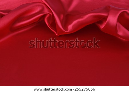 Closeup of folds in red silk fabric - stock photo