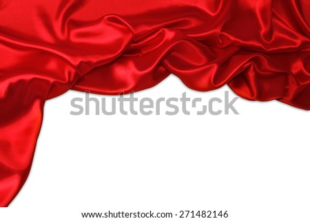 Closeup of folds in red silk fabric on plain background. Advertising copy space  - stock photo