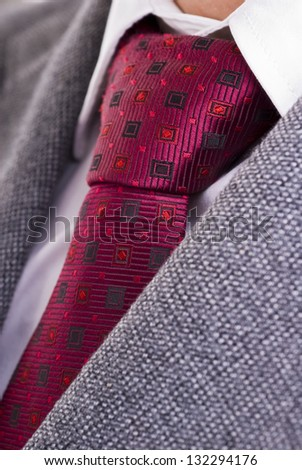 Closeup of formal business attire with necktie, shirt and jacket - stock photo