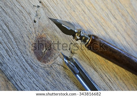 closeup of fountain pen on wooden background  - stock photo
