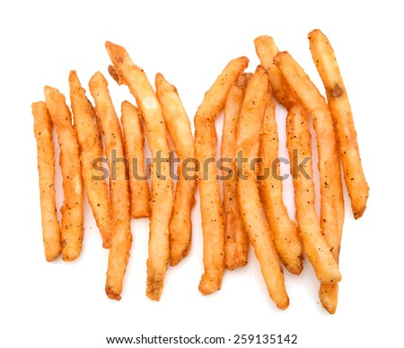 closeup of French fries on white background  - stock photo