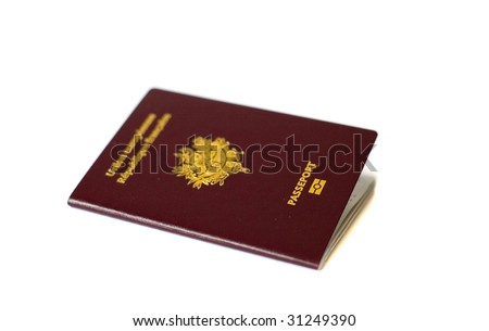 "Closeup of French passport isolated on white. Focus on the word ""Passeport"""