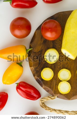 Closeup of fresh assorted vegetables - ingredients for vegetarian dish.