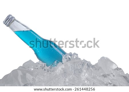 Closeup of fresh beer with blue color in the bottle over ice cube, isolated on white - stock photo