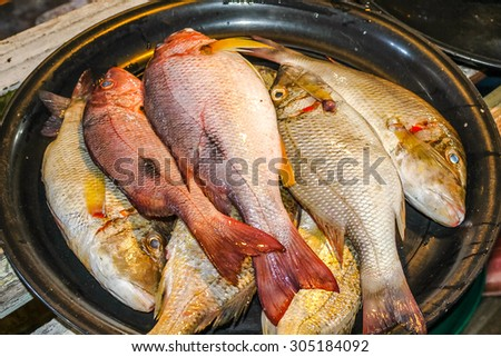 Closeup of fresh fish in a traditional thai market in Chiang Mai town, Thailand