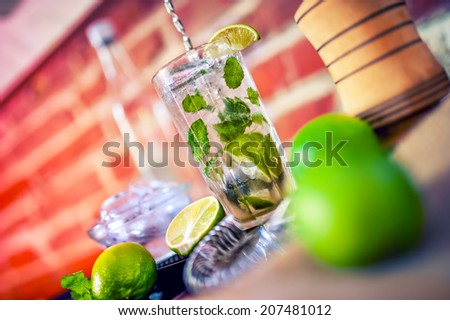 closeup of fresh made mint cocktail drink - stock photo