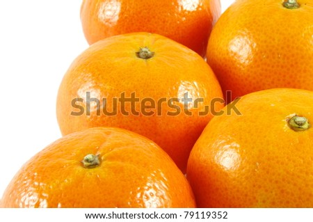 closeup of fresh mandarins over white
