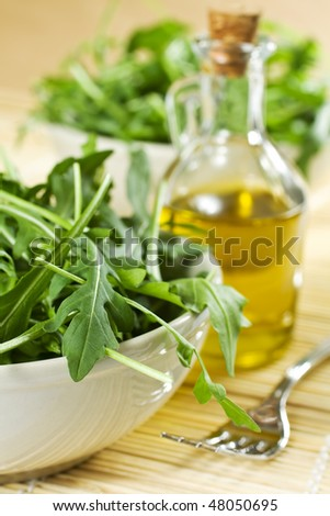Closeup Of Fresh Rucola Salad And Oil - stock photo