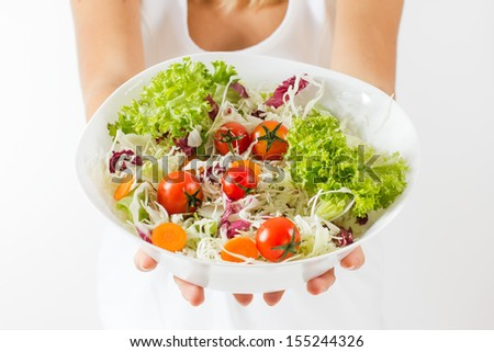 Closeup of fresh salad in a bowl.Healthy food. - stock photo