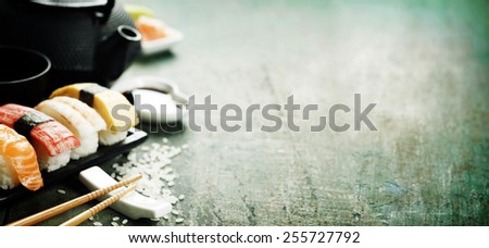 Closeup of fresh sushi  on rustic wooden table - stock photo