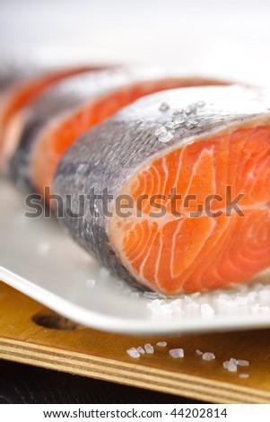Closeup of fresh uncooked salmon steak - stock photo