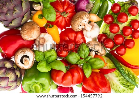 closeup of fresh vegetables and herbs. healthy nutrition background. raw food ingredients. tomato, paprika, artichoke, mushrooms, garlic. selective focus - stock photo