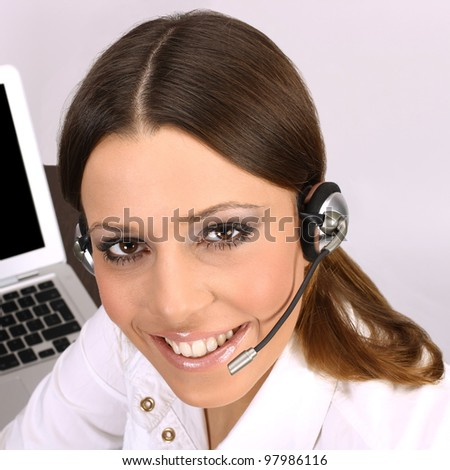 Closeup of friendly call service operator woman. - stock photo