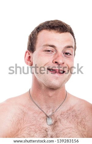Closeup of funny shirtless man sticking out tongue, isolated on white background - stock photo
