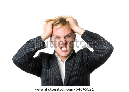Closeup of furious young man on white background - stock photo