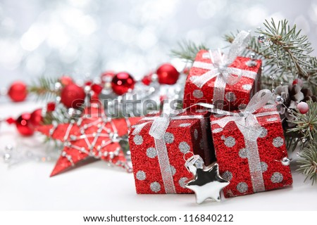 Closeup of gift boxes and pine branch on abstract background. - stock photo