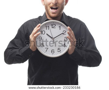 closeup of ginger young man with shirt with a clock