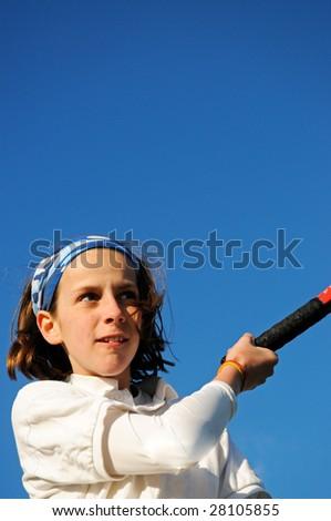 closeup of girl playing tennis - stock photo
