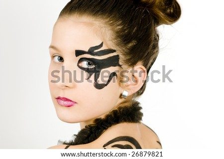Closeup of girl with black scorpio sign painted on back and face - stock photo