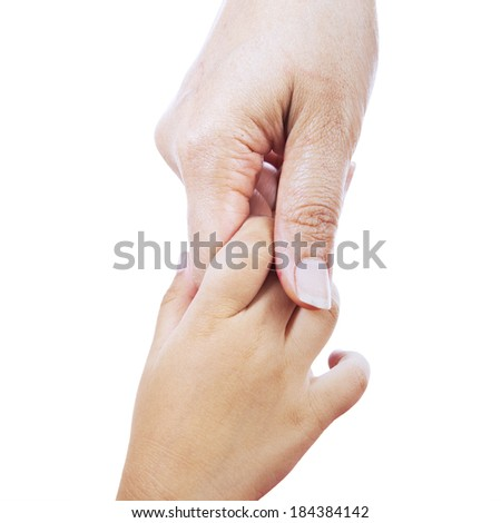 Closeup of giving a helping hand to another. isolated on white background - stock photo