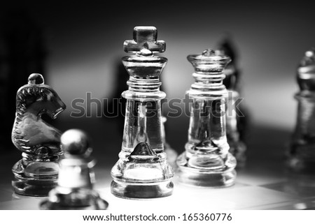 Closeup of glass chess pieces - stock photo