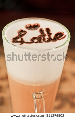 closeup of glass with latte in a cafe