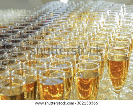 Closeup of glasses of white wine on a table - stock photo