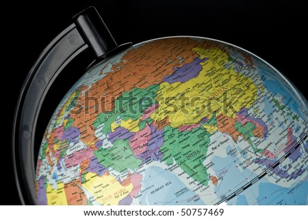 Closeup of globe on black with India and China featured