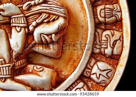 Closeup of glyphs on a Mayan calendar - stock photo