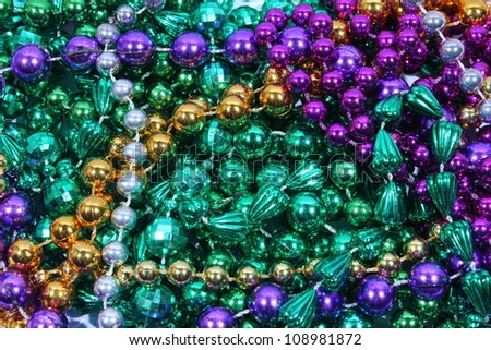 Closeup of gold, green, and purple Mardi Gras beads - stock photo