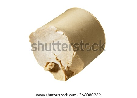 Closeup of gold lipstick on white background